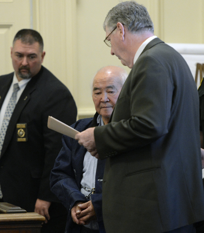 James Pak, center, appears in York County Superior Court in Alfred on Monday to face charges of fatally shooting Derrick Thompson, 19, and Alivia Welch, 18, on Monday in Biddeford. With Pak is his attorney, Joel Vincent, right.