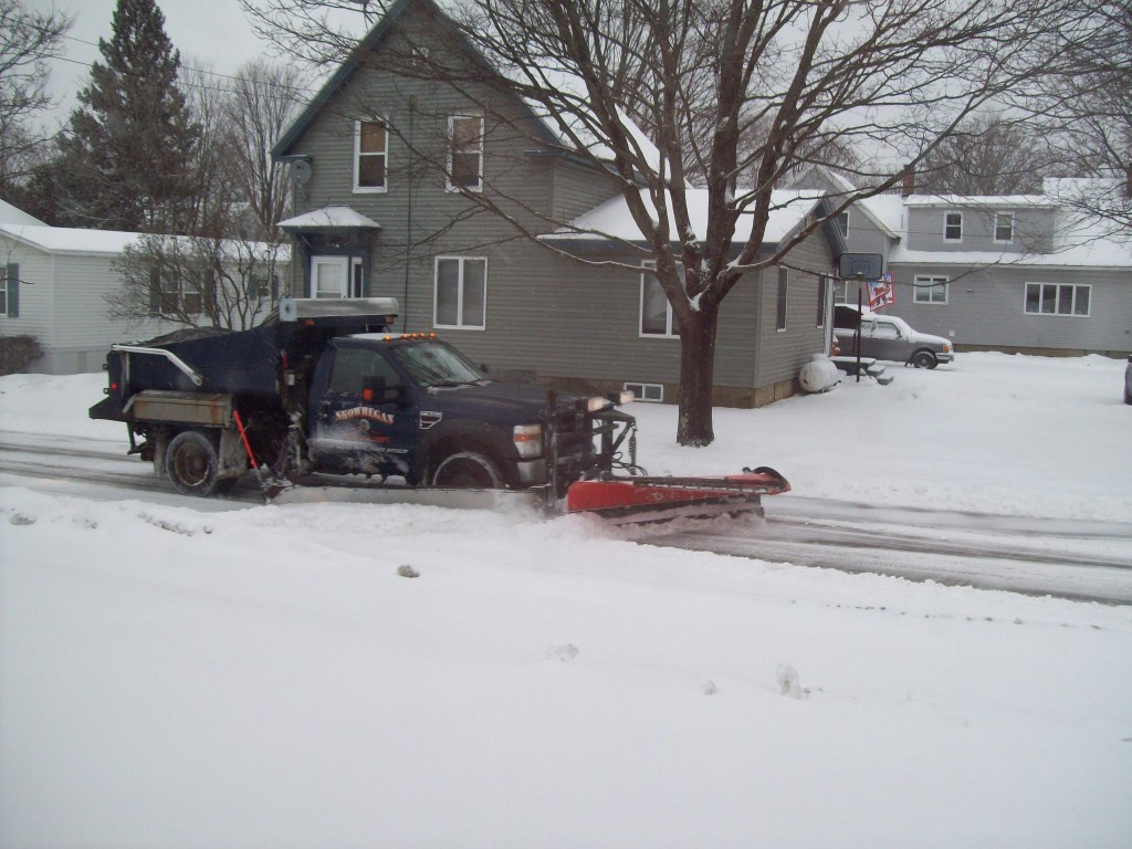 A Skowhegan highway department truck plows on Free Street on Thursday morning.