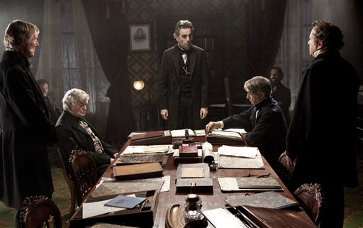 FILE - This undated publicity photo released by DreamWorks and Twentieth Century Fox shows, Daniel Day-Lewis, center rear, as Abraham Lincoln, in a scene from the film,