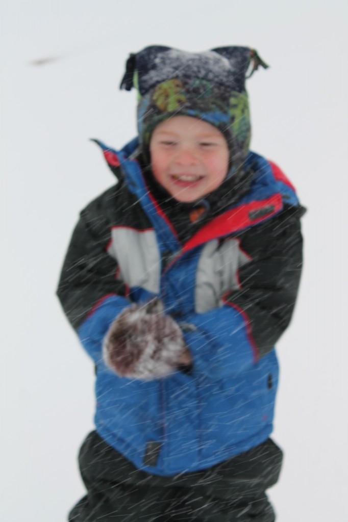 Aaron-Jacoby, 4, of Freedom, enjoys Thursday's snowfall.