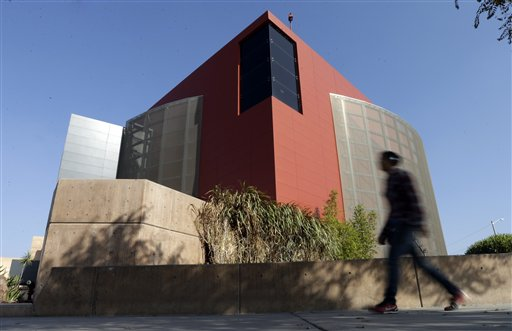 A man walks past an expansion of the Tijuana Cultural Center known as