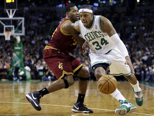 Boston Celtics forward Paul Pierce (34) drives against Cleveland Cavaliers forward Alonzo Gee (33) during the second quarter of an NBA basketball game in Boston, Wednesday, Dec. 19, 2012. (AP Photo/Elise Amendola) TD Garden