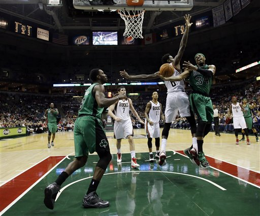 Boston Celtics' Paul Pierce (34) tries to drive to the basket past Milwaukee Bucks' Larry Sanders (8) during the first half of an NBA basketball game on Saturday, Dec. 1, 2012, in Milwaukee.