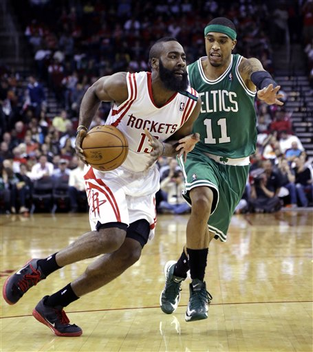 Houston Rockets' James Harden (13) drives to the basket as Boston Celtics' Courtney Lee (11) defends during the third quarter of an NBA basketball game Friday in Houston. The Rockets beat the Celtics 101-89.