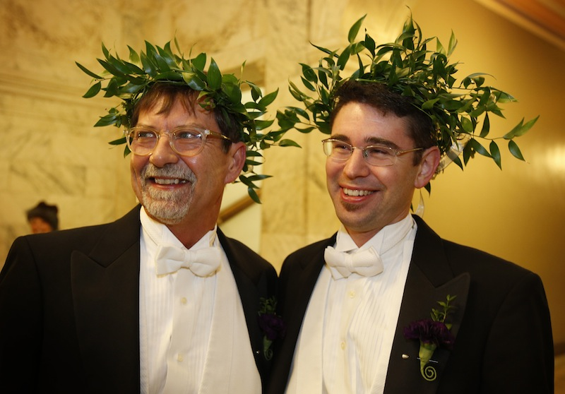 Steven Jones, left, and Jamous Lizotte wear laurel wreaths as they arrive at City Hall to obtain a marriage license, Friday, Dec. 28, 2012, in Portland, Maine. Same-sex couples in Maine will be allowed to marry as a new law goes into effect at 12:01 AM Saturday, Dec. 29, 2012.(AP Photo/Robert F. Bukaty)