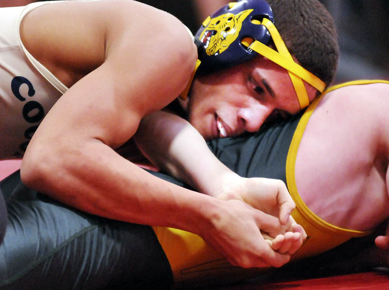 Khalil Newbill of Mt. Blue High School, left, attempts to pin Oxford Hills Comprehensive High School's Jon Hankey Saturday at the Cony Duels in Augusta. Newbill won the match 9-0.