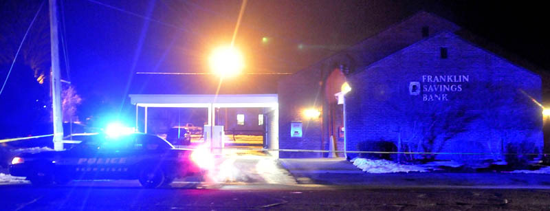 A Skowhegan police cruiser sits parked next to Franklin Savings Bank on Madison Avenue after a robbery on Dec. 13.
