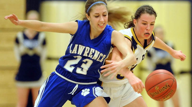 Lawrence High School's Paige Belanger left, and Mt. Blue High School's Miranda Nicely battle for the loose ball in the second quarter Friday at Mt. Blue High School in Farmington.