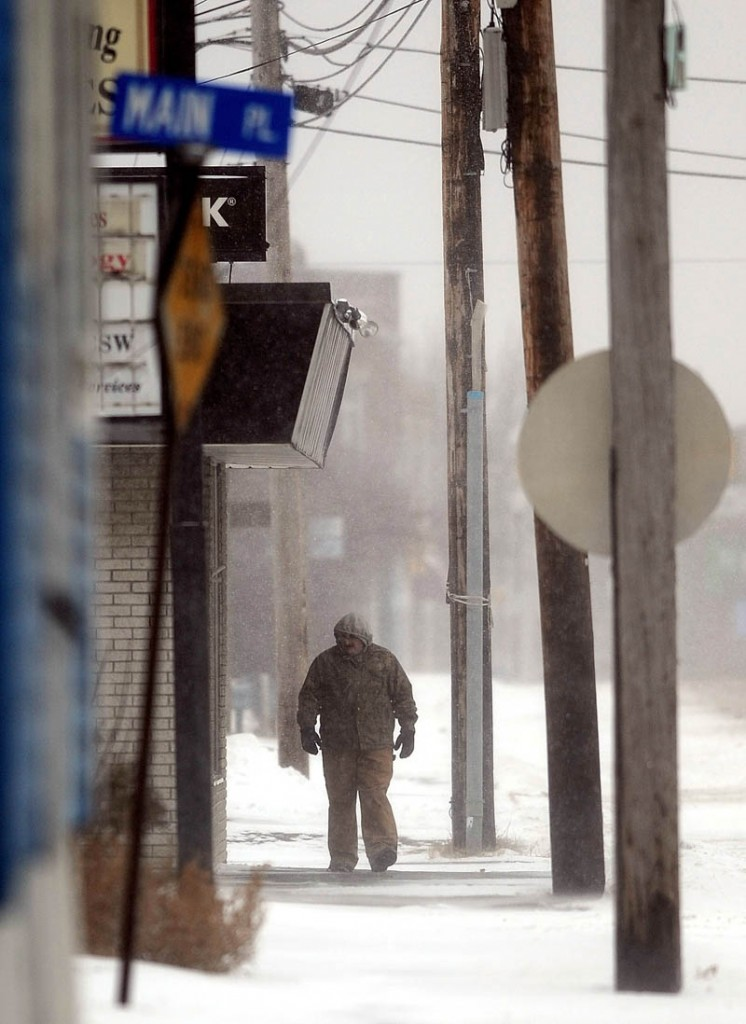 A man battles through the snow on a walk down South Main Street in Waterville on Thursday.