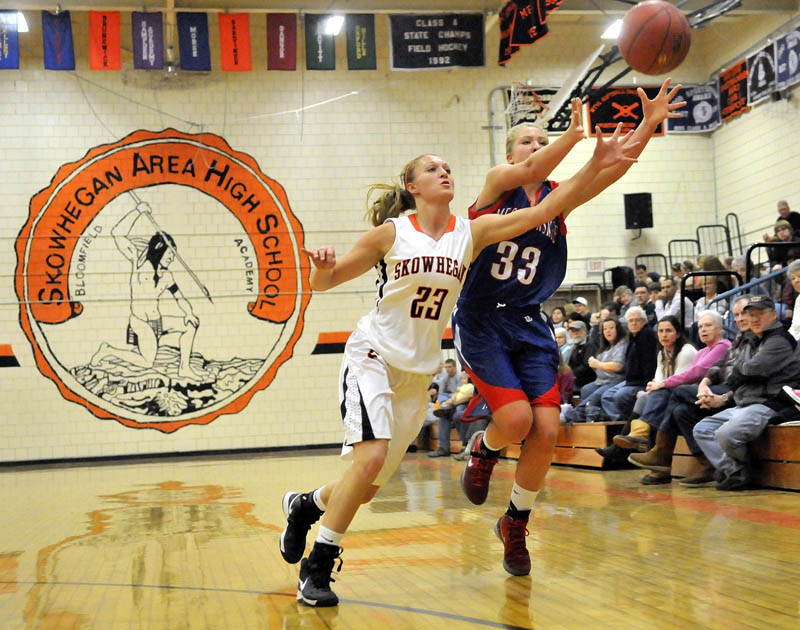 GOOD EFFORT: Skowhegan Area High School's Adriana Martineau, left, tries to steal a pass intended for Messalonskee High School's Mikayla Turner in the first quarter of the Eagles' 56-46 win Saturday in Skowhegan.