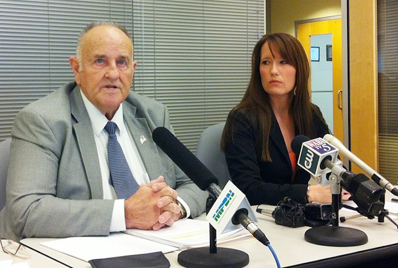 Sawin Millett Jr., the commissioner of the Maine Department of Administrative and Financial Services, and Adrienne Bennett, Paul LePage's spokeswoman, at a press conference Dec. 3.