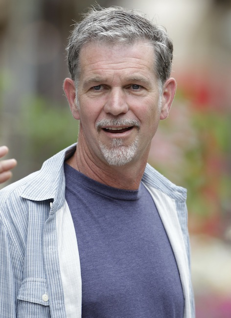 """In this July 11, 2012 file photo, Netflix CEO Reed Hastings attends the Allen & Company Sun Valley Conference in Sun Valley, Idaho. Netflix Inc. is facing scrutiny from government regulators for a Facebook post by Hastings in July that may have boosted the online video company's stock price. Neflix said Thursday, Dec. 6, 2012, that the Securities and Exchange Commission informed it that its staff is recommending civil action be brought against the company and Hastings. The reason: Hastings' July 3 post in which he said Netflix's online video viewing """"exceeded 1 billion hours for the first time ever in June."""" (AP Photo/Paul Sakuma, File)"""