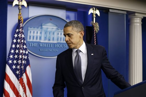 President Obama leaves the podium after speaking about the school shooting in Newtown, Conn., on Friday, in the briefing room of the White House. This evening, Obama will visit privately with families of the victims and with emergency personnel who responded to the shootings. He then will then speak at an interfaith vigil at Newtown High School.