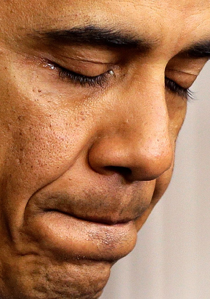 President Barack Obama tears up as he speaks about the school shooting in Newtown, Conn., Friday, Dec. 14, 2012, in the briefing room of the White House in Washington. (AP Photo/Charles Dharapak)