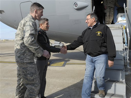 Defense Secretary Leon Panetta shakes hands with 10th Tanker Base Commander Brig. Gen Serdar Gulbas, center, Col. Christopher E. Craige, at left, Commander of the 39th Air Base Wing at Incirlik Air Base in Turkey on Friday.