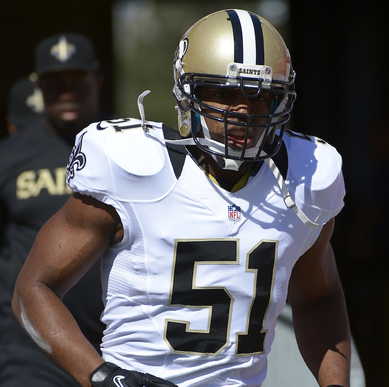 This Oct. 21, 2012 file photo shows New Orleans Saints football linebacker Jonathan Vilma (51) running onto the field in Tampa, Fla., Sunday, Oct. 21, 2012. In a sharp rebuke to his successor's handling of the NFL's bounty investigation, former Commissioner Paul Tagliabue overturned the suspensions of four current and former New Orleans Saints players in a case that has preoccupied the league for almost a year. Vilma was one of those suspended. (AP Photo/Phelan M. Ebenhack, File)