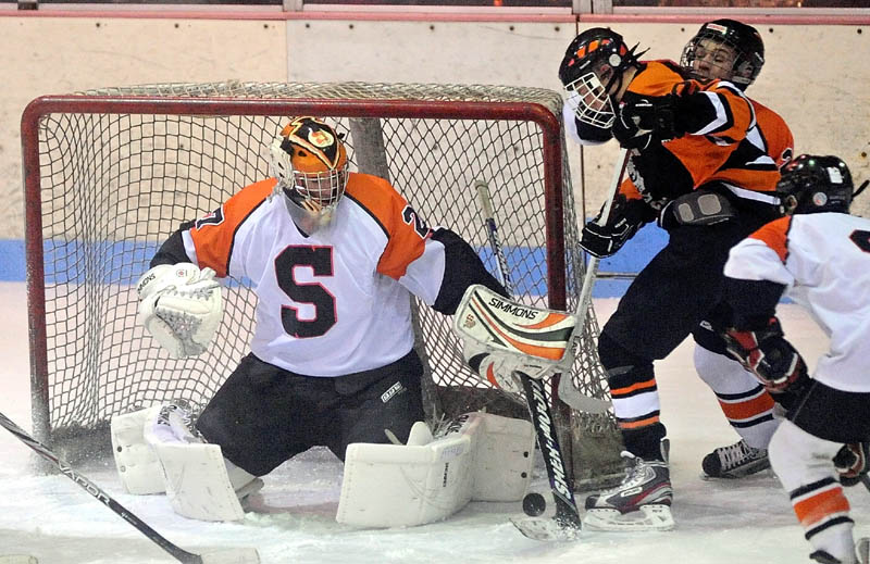 Skowhegan High School goalie, Sam Edmondson makes a save in the first period Wednesday at Sukee Arena in Winslow.