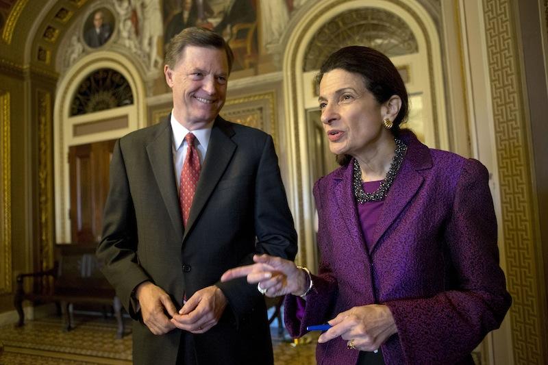Retiring Sen. Olympia Snowe, R-Maine, accompanied by her husband, former Maine Gov. John