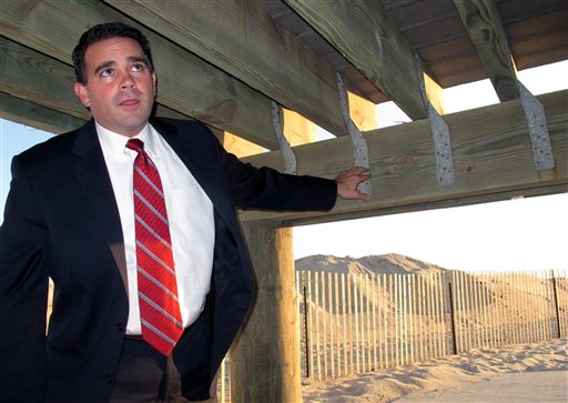 Belmar, N.J., Mayor Matthew Doherty points to hurricane tie-down straps under the one tiny section of boardwalk in his community that survived Superstorm Sandy. The borough used the straps in an experimental section to see if it withstood storm damage better than normal boardwalk construction. Belmar is spending $20 million to rebuild its boardwalk, and will use the tie-down straps on the entire new project.