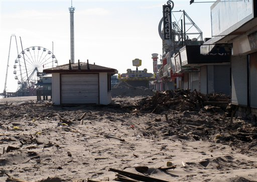Rubble sits where the boardwalk used to be in Seaside Heights, N.J. Seaside Heights, like many other coastal towns, is racing to rebuild its boardwalk from Superstorm Sandy's damage in time for next summer's tourism season.