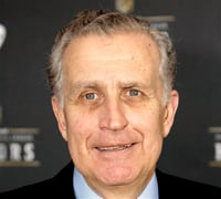 This Feb. 4, 2012 file photo shows former NFL Commissioner Paul Tagliabue in Indianapolis. In a sharp rebuke to his successor's handling of the NFL's bounty investigation, former Commissioner Paul Tagliabue overturned the suspensions of four current and former New Orleans Saints players in a case that has preoccupied the league for almost a year. (AP Photo/David Stluka, File)