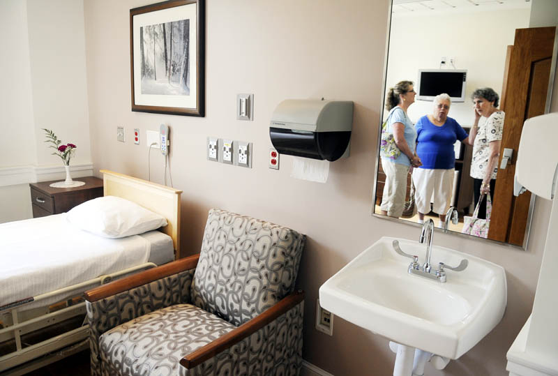 CARING: Therese Lacasse, right, Betty Dutil, center, and Irene MacNaughton inspect a room Tuesday at the new Hospice and Pallative Care ward at the Togus VA. Dutil's husband, Lacasse and MacNaughton's brother, received care at Togus while as he died.