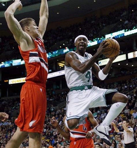 Boston Celtics' Jason Terry (4) looks to shot against Portland Trail Blazers' Meyers Leonard during the first quarter of an NBA basketball game in Boston, Friday, Nov. 30, 2012. (AP Photo/Michael Dwyer)
