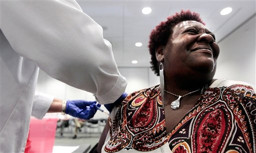 Elizabeth Saint Victor winces as she gets a free flu shot from LPN Jean Buck courtesy of Baptist Healthcare in Memphis, Tenn., recently.