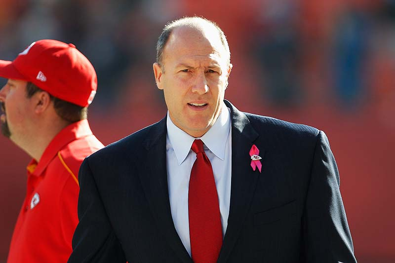 Kansas City Chiefs General Manager Scott Pioli walks on the field before Sunday's game against the Carolina Panthers at Arrowhead Stadium in Kansas City, Mo., a day after Chiefs linebacker and former UMaine player Jovan Belcher killed himself after fatally shooting his girlfriend.