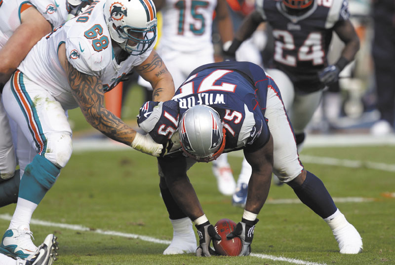 BIG PLAY VINCE: Defensive tackle Vince Wilfork (75) was a major contributor as the New England Patriots racked up a seven-game winning streak. NFLACTION12;