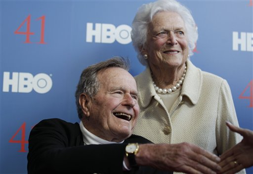FILE - In a Tuesday, June 12, 2012 file photo, former President George H.W. Bush, and his wife, former first lady Barbara Bush, arrive for the premiere of HBO's new documentary on his life near the family compound in Kennebunkport, Maine. Bush spokesman Jim McGrath said Wednesday, Dec. 26. 2012 that doctors at the Houston hospital where Bush has been treated for a month remain