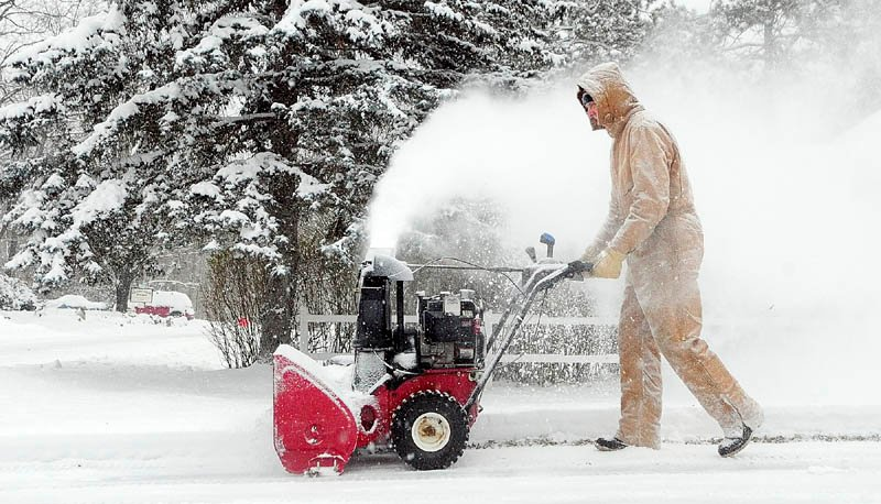 Larry Morrissette clears the driveway with a snow blower Dec. 17 in Hallowell. Portland and southern and coastal Maine are looking at as much as 10 inches by Thursday's end, as a major storm heads toward the Pine Tree State.