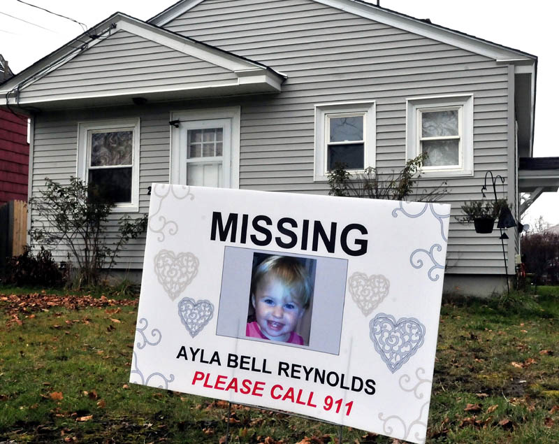 A sign and photograph of Ayla Reynolds has been placed in front of 29 Violette Ave. in Waterville, where she was reported missing nearly a year ago, on Nov. 25.