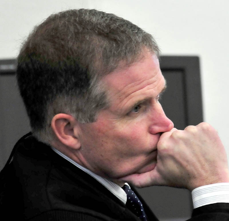 Justice John Nivison listens to closing arguments during the murder trial of Robert Nelson in Somerset County Superior Court in Skowhegan on Tuesday. Nivison said he would reach a verdict later this month.