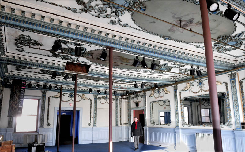 Realtor Tom Munson walks through the ornate dining room at the former Gerald Hotel in Fairfield recently. The Main Street fixture building has been sold and will be renovated into apartments for low-income seniors.
