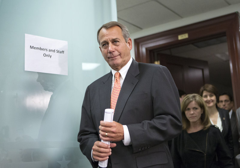 House Speaker John Boehner abruptly called off a vote on a partisan plan to avert the year-end