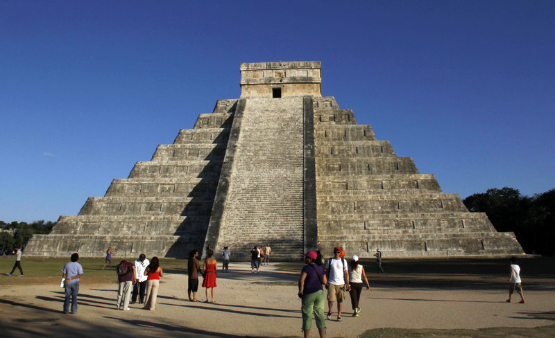 "The Mayan ruins at Chichen Itza, Mexico, attract visitors Thursday. Meanwhile, hundreds of spiritualists gathered at a convention center in the Yucatan city of Merida, an hour and a half away. ""It is a cosmic dawn,"" one declared."