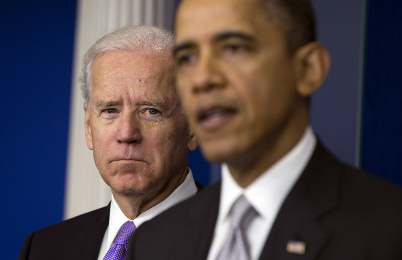 Vice President Joe Biden listens Dec. 19 as President Obama announces that Biden will lead an administration-wide effort to curb gun violence in response to the Connecticut school shooting that killed 20 children and six adults. The president supports a ban on assault weapons.