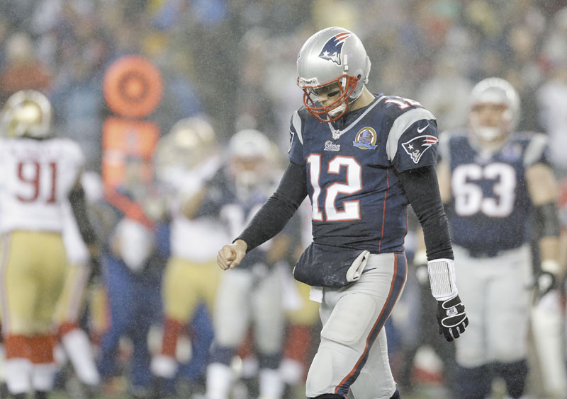 TOUGH ENDING: Quarterback Tom Brady helped New England rally from a 28-point deficit to tie their game against the San Francisco 49ers on Sunday night but the Patriots ultimately lost the game 41-34. Gillete Stadium
