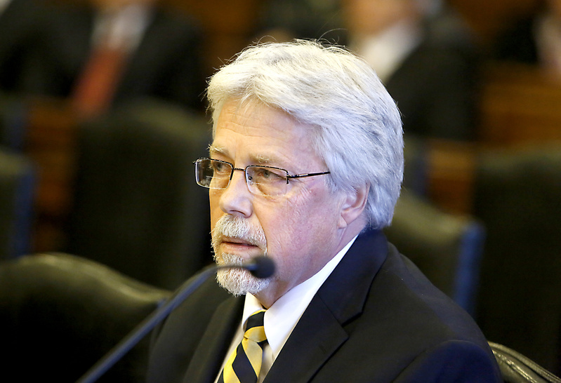 Mark Strong Sr. listens to the judge during his arraignment on Oct. 10 at the Cumberland County Courthouse in Portland. The prosecution against Strong has suffered a number of setbacks, leaving the status of his trial in doubt, with potential jurors ordered to call a court hotline Monday morning for further instructions.