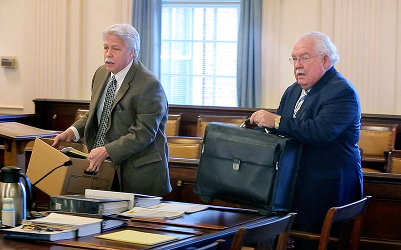 Mark Strong Sr., left, and his attorney Daniel Lilley arrive Wednesday in York County Superior Court in Alfred. Strong has pleaded not guilty to 59 misdemeanors in the case.