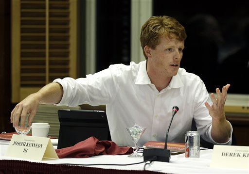 Newly elected U.S. Representative Joseph Kennedy III, D-Mass, asks a question during a panel discussion entitled