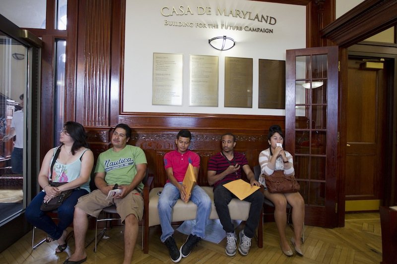 This Aug. 15, 2012 file photo shows applicants waiting in Casa de Maryland in Langley Park, Md., before they can apply for the Deferred Action Childhood Arrivals, as the U.S. started accepting applications to allow them to avoid deportation and get a work permit _ but not a path to citizenship. More than 6 in 10 Americans now favor allowing illegal immigrants to eventually become U.S. citizens, a major increase in support driven by a turnaround in Republicans' opinion after the 2012 elections. The finding, in a new Associated Press-GfK poll, comes as Republicans seek to increase their meager support among Latino voters, who turned out in large numbers to help-re-elect President Barack Obama in November. (AP Photo/Jose Luis Magana, File)