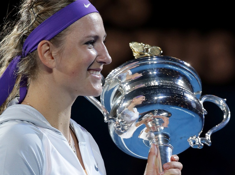 Victoria Azarenka is reflected in the trophy after winning the women's final at the Australian Open tennis championship in Melbourne, Australia, Saturday.