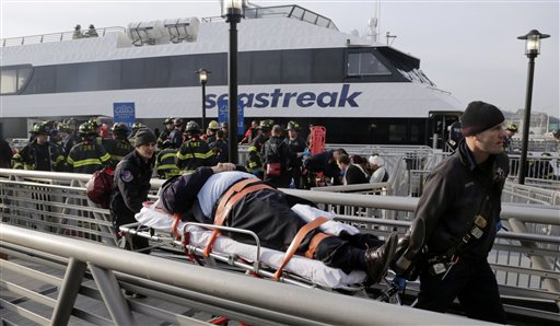 An injured passenger from the Seastreak Wall Street ferry is taken to an ambulance in New York on Wednesday. The ferry from Atlantic Highlands, N.J., banged into the mooring as it arrived at South Street in lower Manhattan during morning rush hour.