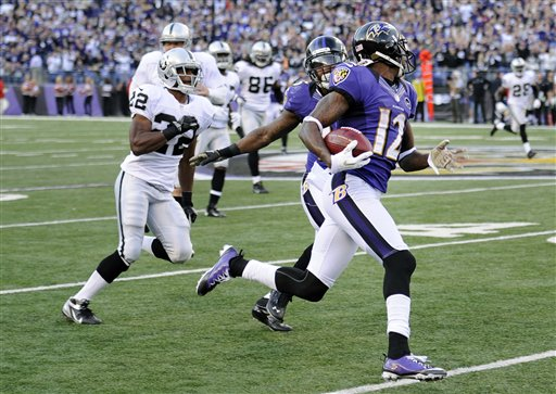 In this Nov. 11, 2012,photo, Baltimore Ravens wide receiver Jacoby Jones (12) looks back as he returns a kickoff 105 yards for touchdown during a game against the Oakland Raiders in Baltimore.