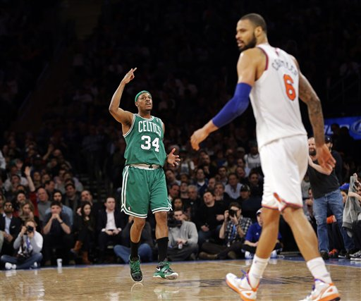 Boston Celtics forward Paul Pierce (34) reacts to a score as New York Knicks center Tyson Chandler walks by in the second half Monday at Madison Square Garden in New York. Pierce led with 23 points as the Celtics won 102-96.