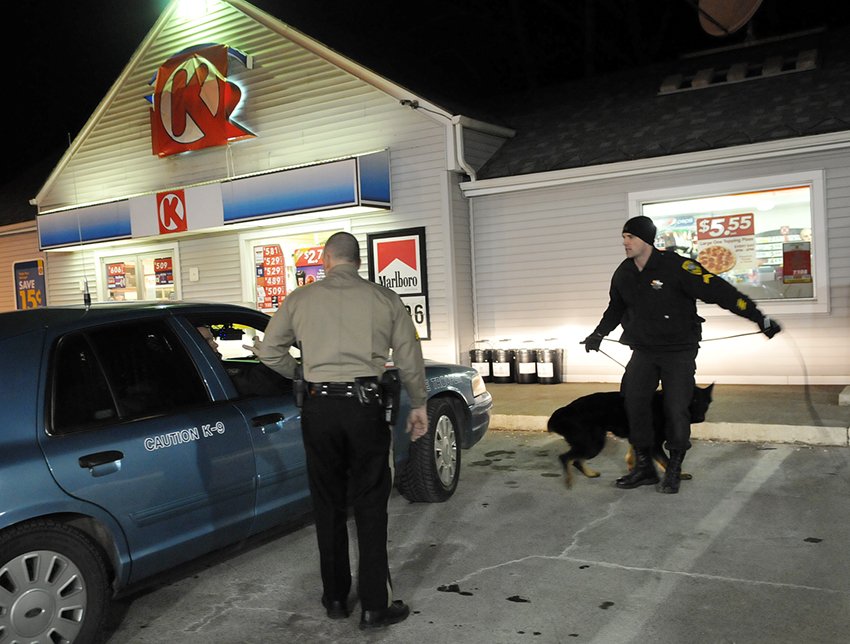 Kennebec County Sheriff's Office deputies and state troopers prepare to track a woman who robbed the Circle K convenience store Sunday evening, on Maine Avenue in Farmingdale. A women, clad in blue jeans and a dark jacket, pointed a handgun at a clerk at the store and demanded money at 7:23 p.m., according to Kennebec County Sheriff's Sgt. Scott Taylor. The robber fled on foot and no injuries were reported, Taylor said.