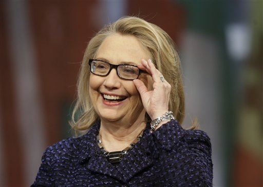 Secretary of State Hillary Rodham Clinton appears at a Global Townterview at the Newseum in Washington on Tuesday. She says she intends to do more public speaking and writing, and work alongside her husband, former President Bill Clinton, and daughter Chelsea on