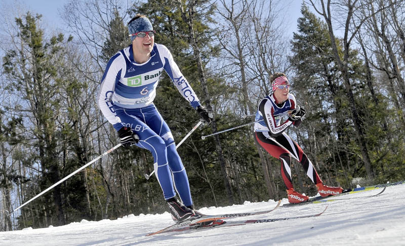 Colby College's Jake Barton, left, and St. Lawrence University's Will Frielinghaus, right, compete in the Colby College Winter Carnival 10K at Quarry Road Recreational Area in Waterville on Saturday.
